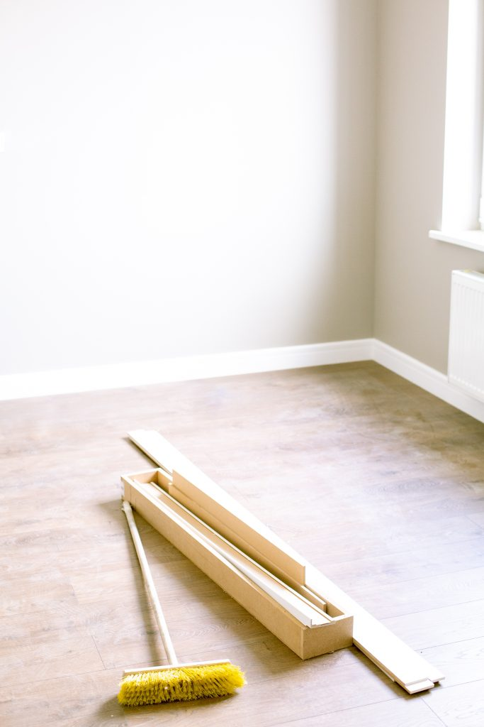 wood planks and floor brush 683x1024 - How to: DIY Flooring Installation
